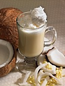 A white chocolate drink with coconut shavings and chocolate chips
