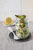 A broccoli and barley salad in a glass jar