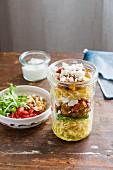 Layered salad with farfallini pasta, pumpkin and feta