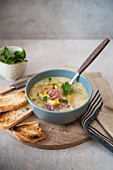Leek and potato soup with ham and toast