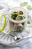 Lunch in a jar: Pancake rolls filled with spinach and cottage cheese in a glass jar