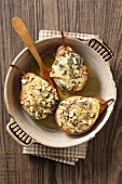 Grilled pears topped with blue cheese and nuts