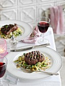 Beef steak with a pepper crust on cabbage and horseradish cream