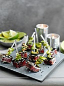 Fish skewers with seared tuna, cucumber and sesame