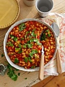 Spicy baked beans with peppers and coriander for brunch