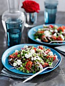 Warm lentil salad with tomatoes, onions and goat's cheese