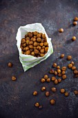 Roasted spicy chickpeas in a paper bag