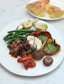 An antipasti platter with vegetables and mozzarella