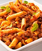 Penne Bolognese with basil