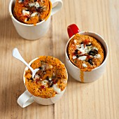 Savoury pizza mug cakes with olives, tomato and cheese