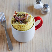 Savoury mug cakes with ham, olives and cheese