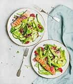 Healthy energy boosting spring salad with grilled salmon, blood orange, olives and quinoa