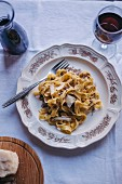Tagliatelle pasta with black truffle served on a vintage plate