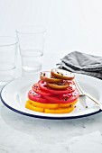 Simple tomatoes salad. Various color tomatoes on enamel plate