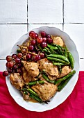 Chicken casserole with grapes, sugar snap peas and asparagus