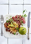 Pan-fried sirloin with shaved pear, pecan nuts and brown butter