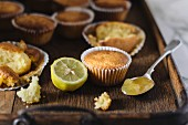Lemon cupcakes on a wooden tray
