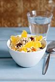 Breakfast cous cous with orange segments