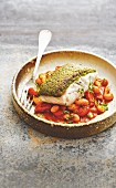 Cod with pesto crust on bean and chorizo cassoulet