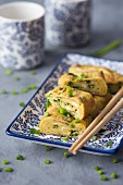 Tamagoyaki (traditional Japanese rolled omlette) with fresh chives