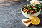 Quinoa salad with broccoli and corn with pitta bread
