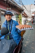 A moped driver with a box of eggs in Seoul, South Korea