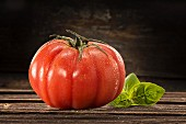 A beefsteak tomato with water droplets