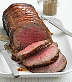A roast sirloin of beef, sliced