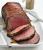 A roast sirloin of beef, sliced
