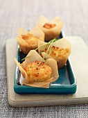 Savoury cheese and onion muffins in baking paper