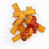 Polenta chips with tomato ketchup (seen from above)
