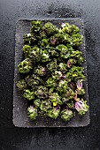 Purple brussels sprouts on a tray
