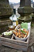 Anchovy chips with wild garlic cheese and wine