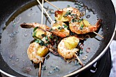 Prawn skewers with pineapple and wild garlic