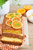 A sliced loaf-shaped orange cake