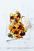 Oven-baked potato, sweet potato and beetroot slices with dip