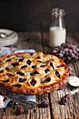 Blackberry pie with double crust and decorative crust on a wooden surface