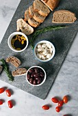 Greek mezze: olives, feta, olive oil and bread