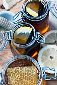 Organic honey with honey comb in mason jar
