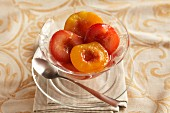 Peach compote in a glass bowl