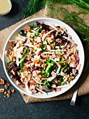 Ham, fennel and quinoa salad on dark background
