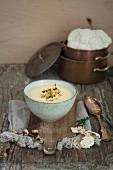 Cauliflower cream soup topped with hazelnuts