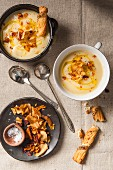 Parsnip cream soup with vegetable crisps (top view)