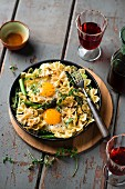 A pasta dish with asparagus and fried eggs