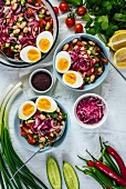Turkish tangy bean salad known as piyaz served in bowls with halved hard-boiled eggs