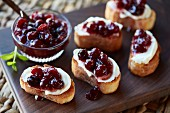 Cranberry sauce and fresh cheese on toasted bread