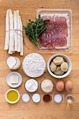 Zutaten für weiße Spargelquiche mit Parmaschinken und Rucola