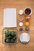 Ingredients for puff pastry parcels filled with spinach and sheep's cheese