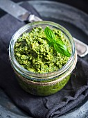 Vegan green pesto in a jar