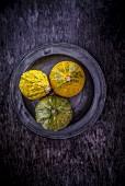 Three pumpkins on a plate